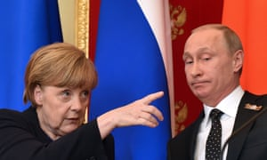 Merkel, gestures at a joint news conference with Russia's President Vladimir Putin