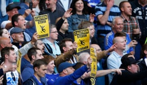 Chelsea's fans hold signs.