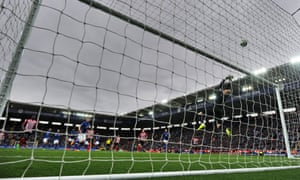 Leicester City's Danish goalkeeper Kasper Schmeichel makes a save against Everton.