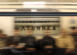"A sign that reads ""Lubyanka"" is seen through a window of a moving train at Lubyanka metro station in Moscow March 30, 2010. Moscow observed an official day of mourning on Tuesday and nervous commuters returned to the metro, while the death toll from twin suicide bombings on the capital's underground railway rose by one to 39 people."