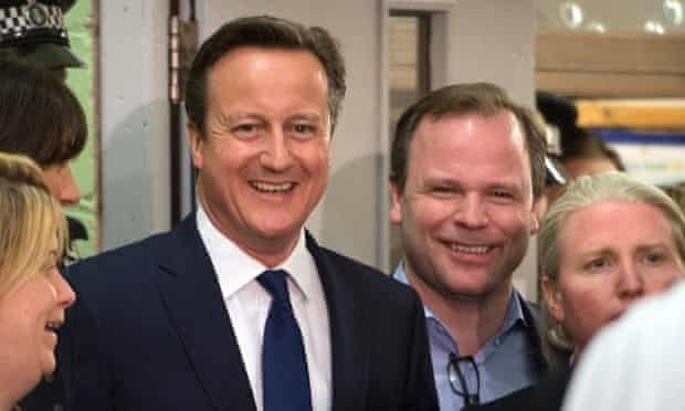 David Cameron and his team including Craig Oliver (right) share a joke before receiving his constituency result in Witney