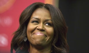 Michelle Obama smiles before she speaks during the Tuskegee University's spring commencement.