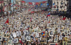 Carrying portraits of relatives who fought in the second world war, a 100,000-strong crowd attends the 'Immortal Regiment' commemoration in St Petersburg at the weekend as Russia marks the 70th anniversary of the defeat of the Nazis
