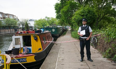 Police have roped off part of the Grand Union canal in west London after a body was found in a suitcase.