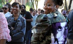 Prince fans queue ahead of the concert, while one, Nikki Harris of Baltimore, shows off her embroidered Prince jacket.