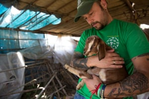 Adam Parascandola with an orphaned baby goat in Kalitaar, a small village outside Kathmandu that was severely damaged by the earthquake.