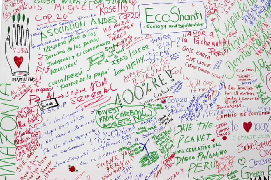 Environmental well wishes are seen writen on a wall on December 13, 2014 in Lima, as commissions continue working on a final document draft of the COP20.