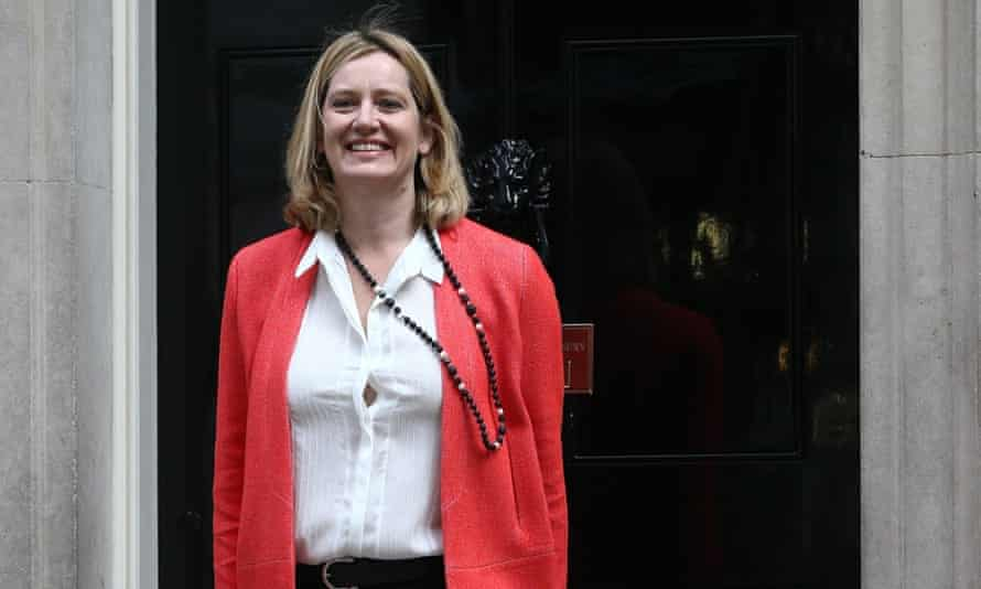 Amber Rudd waves as she arrives at 10 Downing Street. She takes charge as secretary of state for the Department of Energy and Climate Change.