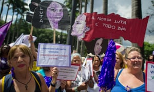 Women protest against violence against women during the celebration of the International Women's Day on March 8, 2013, in Sao Paulo, Brazi