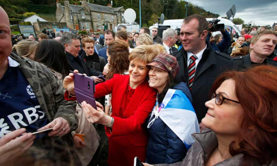 First Minister of Scotland and SNP leader Nicola Sturgeon with her historic 56 newly elected members of parliament including Alex Salmond - seen in South Queensferry in the shadow of the Forth Rail Bridge - after the Westminster General Election Campaign.