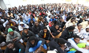 Refugees from Sub-Saharan Africa gather at a centre for illegal migrants in the city of Misrata in northern Libya. The country has been a launchpad for many trying to reach Europe, who turn to people smugglers to cross the Mediterranean.