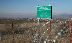 The razor wire along the claimed border - with a sign in Georgian and English.