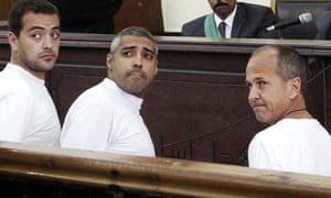Al-Jazeera journalists appear in court along with several other defendants during their trial on terror charges, in Cairo, in January 2015.