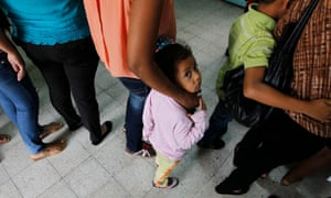 Women and their children wait in line to register at the Honduran Center for Returned Migrants after being deported from Mexico, in San Pedro Sula, northern Honduras June 20, 2014. Thousands of young people are hoping to reach the U.S. from their impoverished and violent homes in Central America. In the eight months ended June 15, the U.S. has detained about 52,000 children at the Mexican border, double the figure the year earlier. There is no telling how many have gotten through. Picture taken June 20, 2014. To match Feature USA-IMMIGRATION/MEXICO     REUTERS/Jorge Cabrera (HONDURAS - Tags: SOCIETY POLITICS IMMIGRATION TPX IMAGES OF THE DAY):rel:d:bm:GF2EA6O18HW01