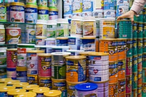 Cans of baby formula are displayed in a pharmacy in the Causeway Bay area of Hong Kong, China.