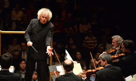 Sir Simon Rattle conducts the Berlin Philharmonic at the Barbican, London, February 2015.