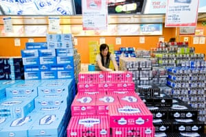 An employee restocks supplies of alcohol for sale aboard the AS Tallink Grupp ferry Baltic Queen.