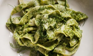 Pappardelle with basil, parsley lemon and pine nuts on a plate
