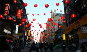 The same Chinatown street with lanterns.