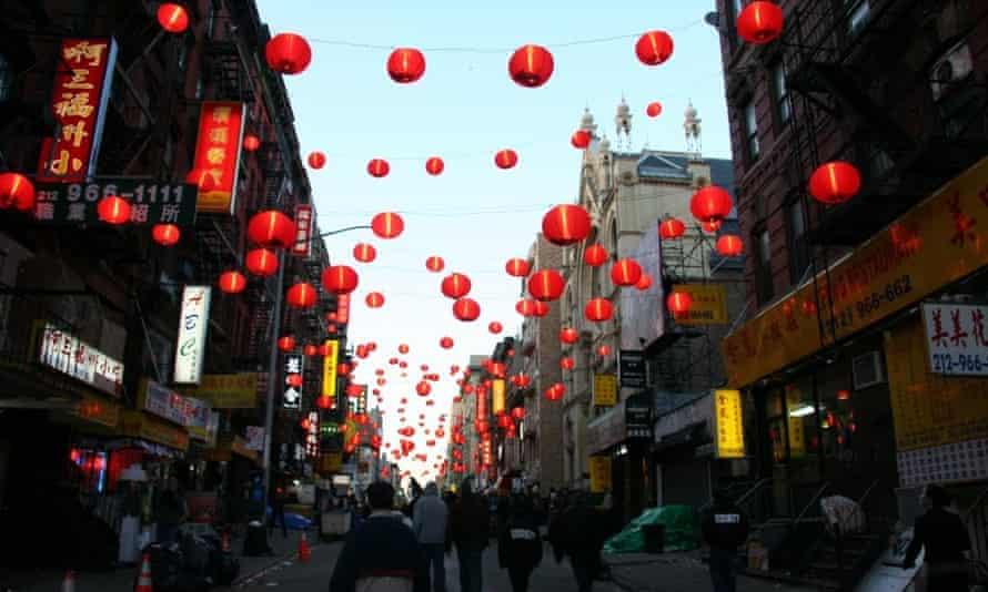 The same Chinatown street with lanterns.