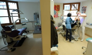 A patient gets dental treatment at a health centre in Budapest.