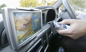 An in-car satellite navigation system in the UK.
