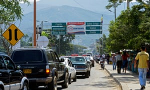 Vehicles and pedestrians approach the Simon Bolivar International Bridge