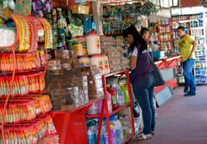 A shopper browses for items at Cenabastos market in Cúcuta, Colombia.