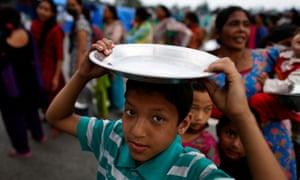 Food distribution at a refugee camp in Kathmandu