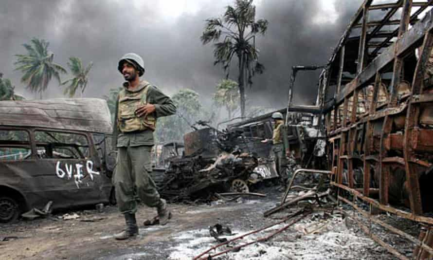 A Sri Lankan soldier walks among debris as the war with the Tamil Tigers came to a close.