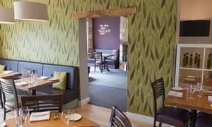 Hanging lamps and tables and chairs at Wild Garlic in Nailsworth, Gloucestershire