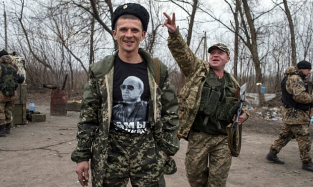 A pro-Russia rebel near Debaltseve wearing a T-shirt showing Russian president Vladimir Putin