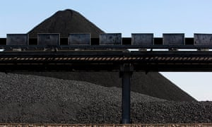 A mound of coal awaits loading onto a ship for export at Newcastle port, north of Sydney, Australia,