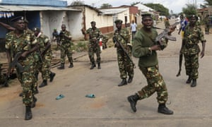 Soldiers disperse a crowd by firing into the air after demonstrators cornered  a suspected member of the ruling party's Imbonerakure youth militia in the Cibitoke district of Bujumbura, Burundi.