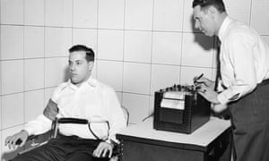 American inventor John Larson, right, demonstrates the operation of a polygraph or 'lie detector' at Northwestern University, Evanston, Illinois, in the 1930s.