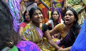 Women mourn the death of their relative who died after a wall collapsed in Bihar, India.