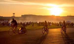 Visitors relax and enjoy barbecues beside the former runway of Tempelhof airport.