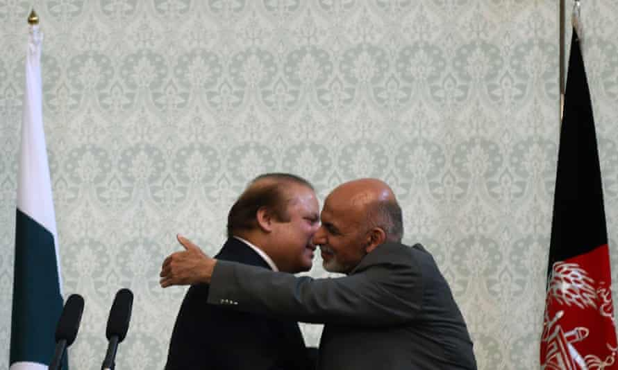 Afghanistan's President Ashraf Ghani, right, embraces the Pakistani prime minster, Nawaz Sharif, at the presidential palace in Kabul.