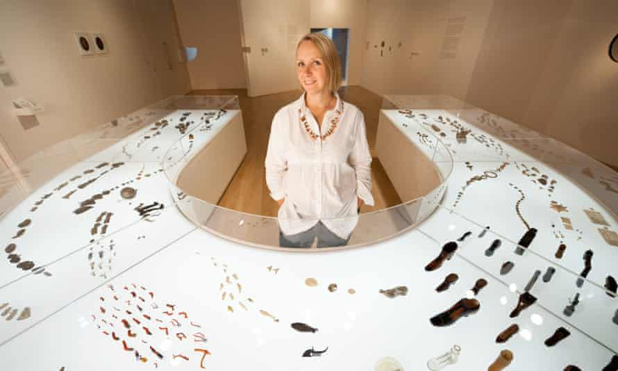 Felicity Powell with her display for Charmed Life: The Solace of Objects at the Wellcome Collection, central London, 2011. She designed and built the horseshoe-shaped illuminated vitrine to display a shoal of lucky charms.