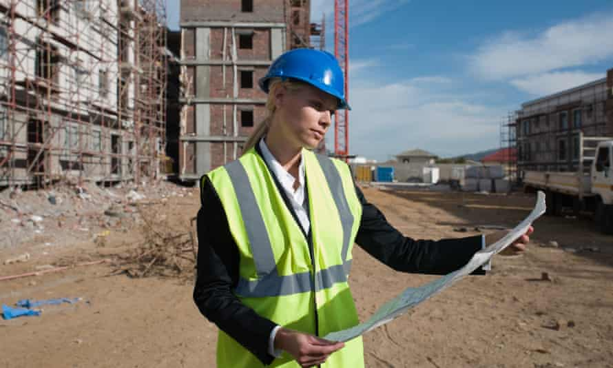 women on building site holding site papers