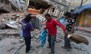 People search near a collapsed house in Kathmandu after another powerful earthquake.