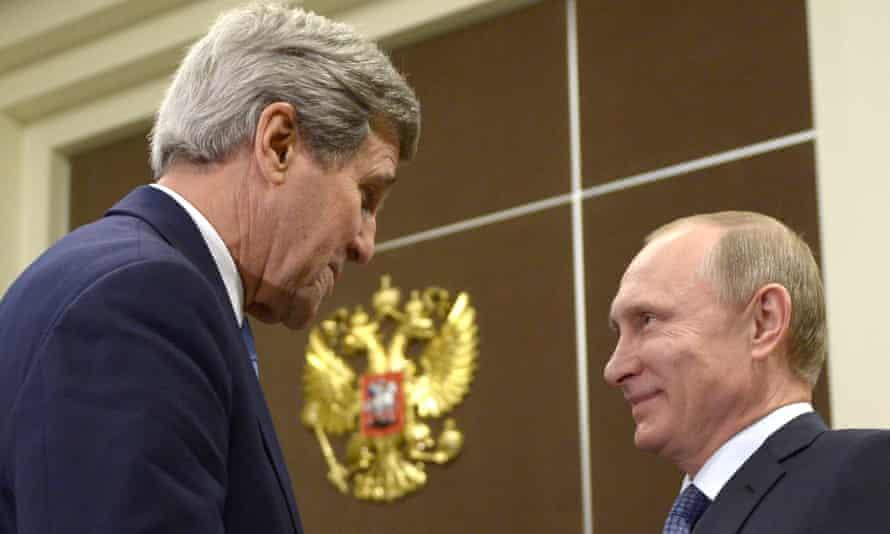 John Kerry and Vladimir Putin shake hands.