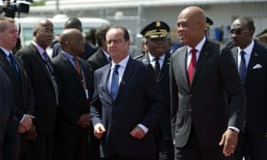 French president François Hollande is welcomed by the President of Haiti, Michel Martelly upon his arrival in Haiti.