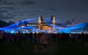 <strong>Amsterdam, Netherlands </strong>People watch a light show by Dutch artist Daan Roosegaarde called Water Light, at Rijksmuseum which creates the impression of water and floods on Museumplein square.