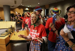 <strong>Seattle, Washington US</strong> Shirley Morrison (c) and other members of the Seattle Raging Grannies sing a song opposing Shell Oil during a meeting of the Port of Seattle Commission to address the status of a Port lease with Foss Maritime, which would allow the Shell Oil. Company to base equipment in Seattle that is used to drill for oil off the coast of Alaska