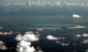Aerial photo of apparent land reclamation under way in the Spratly Islands of the South China Sea.