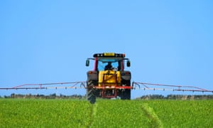 A farmer spraying crops near Thurstonland in Holme Valley, West Yorkshire.