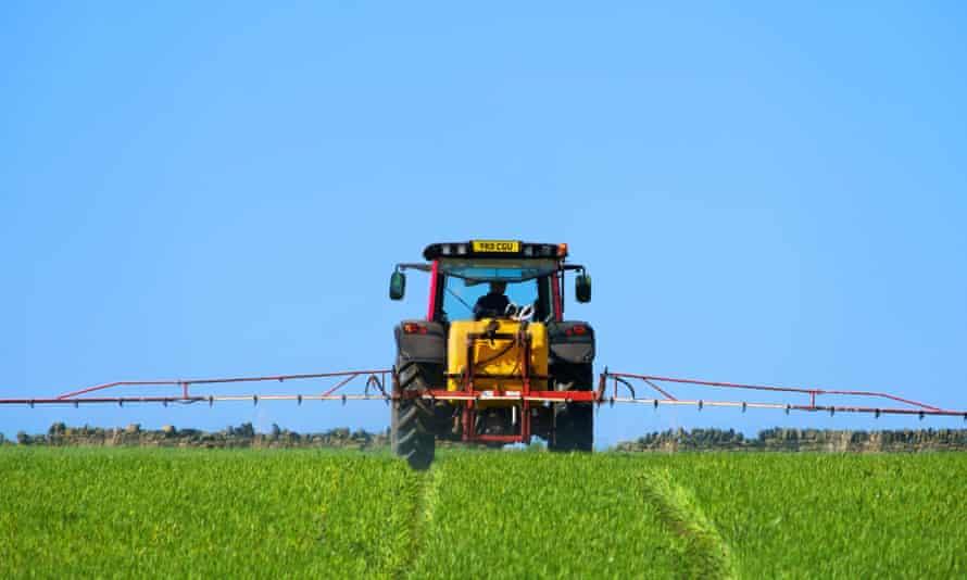 A farmer spraying crops near Thurstonland in Holme Valley, West Yorkshire.