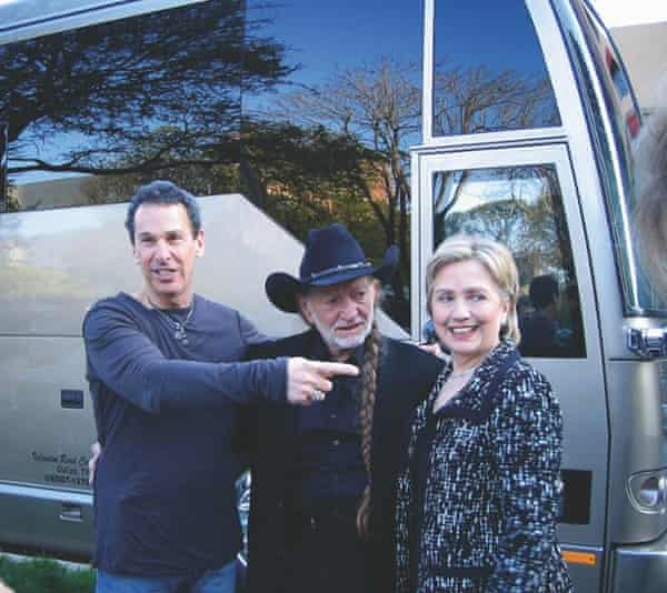 Willie Nelson in front of his tour bus with his manager, Mark Rothbaum, and Hillary Clinton