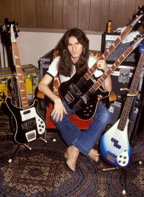Geddy Lee backstage with his collection of bass guitars